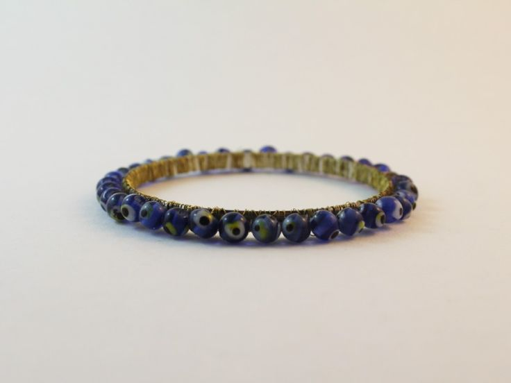 Check out this DIY jewelry revamp! This bangle was boring... so I threw some beads around it!