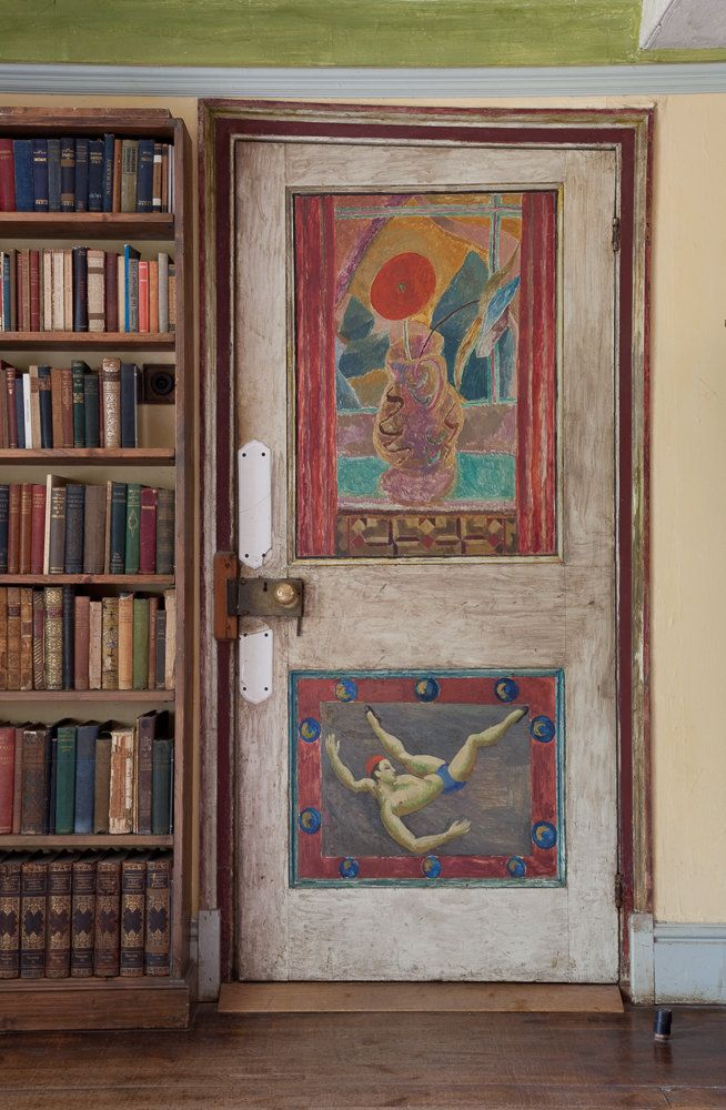 Clive Bell's study door at Charleston, with paintings by Duncan Grant. The top panel dates from 1917. The bottom panel, featuring an acrobat, was painted in 1958.