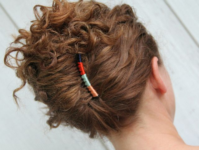 hair combs by KristinaJ - cute embroidery floss decorated combs.