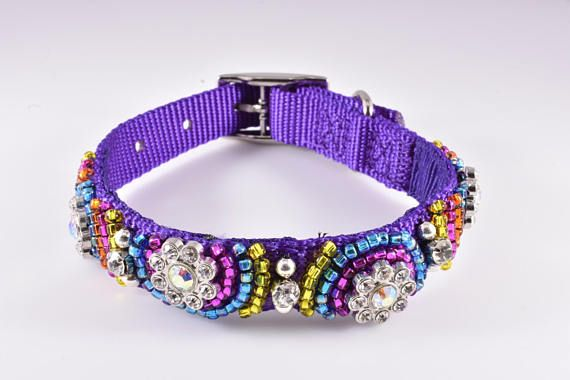 Purple dog collar is covered with various fetching colors of seed beads: pink, yellow, and blue. Rhinestone flower beads are placed artistically through the collar. Do you like bright colors? Then you will love your fashion forward pup in this collar. A pawsome array of colors is displayed in this rainbow inspired collar. Sophisticated details for a sophisticated pup. The wonfurful high quality and eye fetching design will ensure that you have the most fabulous furry fashionista at the the…