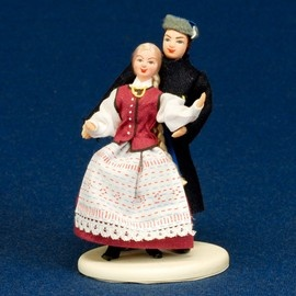 "Folk Doll - Warmia, Couple 5.0""  Dolls from Poland are a perfect miniature replica of the real costumes used in Poland. Whether you love to play with dolls, love Polish costumes, or collect elaborate unique dolls, these are for you.    The doll bodies are made of plastic and plaster. The pair sands together on a wooden base wearing traditional folk costumes from the Warmia region. Dolls have no moving parts.    Dolls stand approx. 5.0"" Tall  Hand Made in Poland"