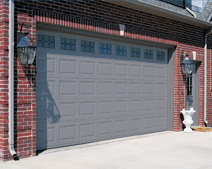 Red Brick House With A Garage Door And Front Door Color
