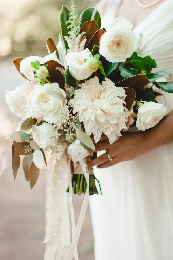 Ivory Rose and Dahlia Bridal Bouquet with Magnolia Leaves and Fresh Greenery | Sur La Lune Photography | See More! http://heyweddinglady.com/twenties-style-meets-boho-glam-wedding-by-sur-la-lune/