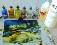 Add interesting textures to Alcohol Ink Dreamscapes with Acrylic Glazing Liquid. Shown: colors and metallics used to create Dreamscape No. 580. Learn how on Alcohol Inks and Acrylic Glazing Liquid DVD. Dreamscaping With June Rollins®
