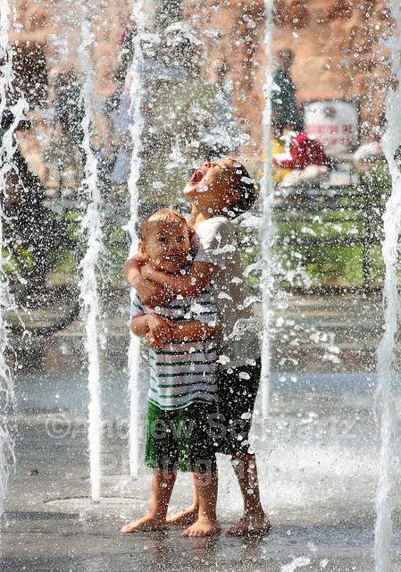 Kids enjoy the fountain inside Battery Park in New York City.