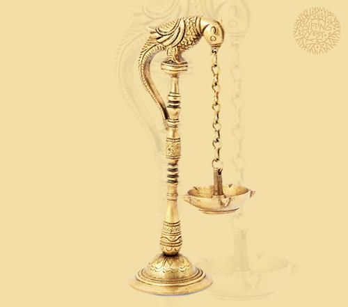 PARROT-HOLDS-A-LAMP: Wouldn't a diya hanging from a parrot's beak look beautiful on a dining table as your friends have dinner? Or on your nephew's study table as he sits reading a book till late? Well, this enchanting brass lamp is quaint and just the right gift for your dear ones.