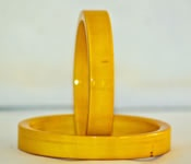 Plain Yellow coloured wooden hand crafted bangle. Colour of yellow is obtained from turmeric and mixed with lacquer