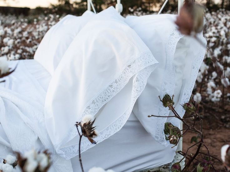 Our Madeline Gray luxury cotton bed sheets are inspired and named after the beautiful woman who passed down the very heirloom linens all our linens are modeled after. These beautiful, soft, and crisp linens are adorned with cotton lace that extends from the hem of our top sheets and pillowcases. As always, our linens are proudly made in the USA!