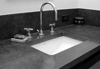 Concrete countertops! I like :) if we ever own a house all my counters will be concrete, even the bathrooms.