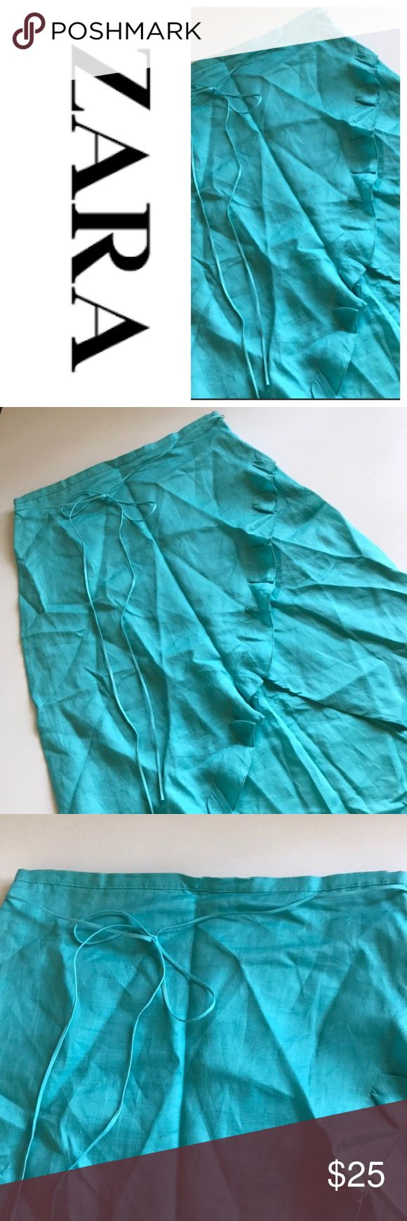 """NWOT Zara Teal Wrap Ruffle Skirt Sz M Brand: NWOT Zara   Color: Teal Blue  Style: Stunning A-line Skirt with side zip. Knee length. Mini tie belt. Front ruffle Scallop slit opening. Plain back. *Tiny flaw show in last pic  Materials: 100% Ramie (feels like linen)  Size: Medium  Waist: 15.5"""" Hips: 22"""" Length: 28""""  🍍🍍🍍 NWOT New without Tags. Bundle & Save with my Other Listings! Zara Skirts High Low"""