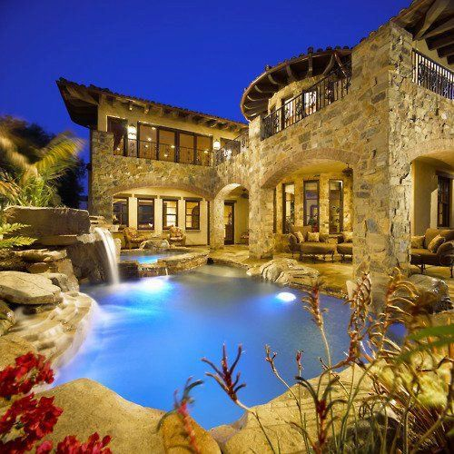 Not a big pool kind of guy, but this really works with the house. Love the exposed stone and wood and waterfall in the pool.