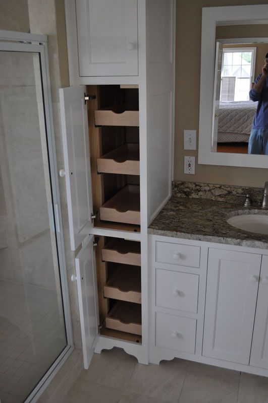 Bathroom cabinet idea...sliding shelves.