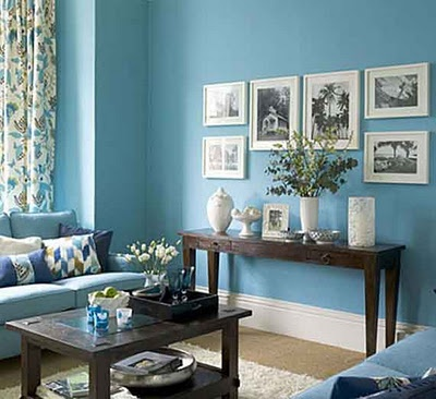 blue living room white frames wood accents