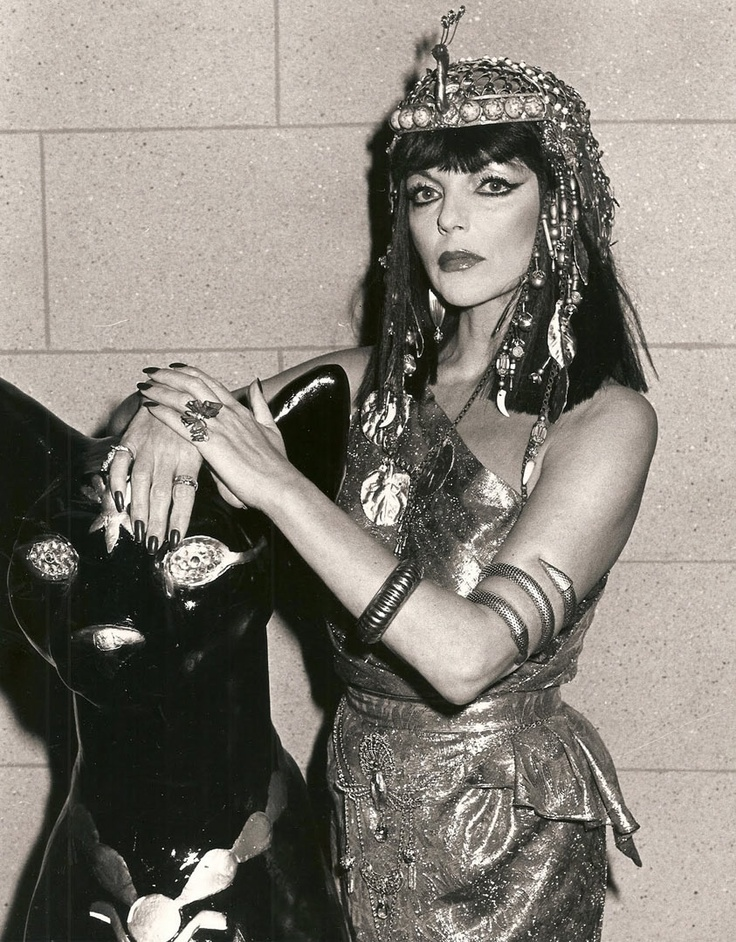 Joan Collins as a pretend Cleopatra from a guest spot on FANTASY ISLAND. In the episode, Joan's fantasy is to go back in time when Cleopatra ruled Egypt. In the story, she's used as a substitute for the real Cleopatra (who's in a dungeon) to seduce Mark Anthony (Ron Ely) and keep him company (sorta a twist on TWO NIGHTS WITH CLEOPATRA with Sophia Loren). Oddly enough, Joan was mentioned as a potential replacement of Elizabeth Taylor for CLEOPATRA when Taylor became ill and delayed…