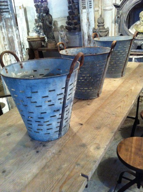 vintage steel olive baskets, great for storage, potted trees or as decorative pieces. Repinned by www.silver-and-grey.com