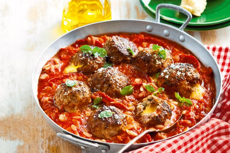 The #pasta cooks in the oven with these gooey cheese-centred #meatballs.