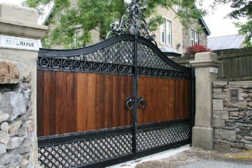 I really love the fusion of iron and wood on this entry gate it makes it look almost impenetrable!  Viking swing gate