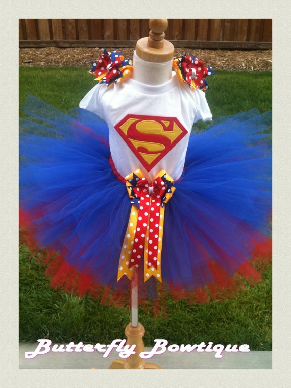 My husband is such a SuperMan freak, he would totally flip if he saw his girls in this adorable little outfit. Maybe for Halloween, or even do a super hero themed bday party.