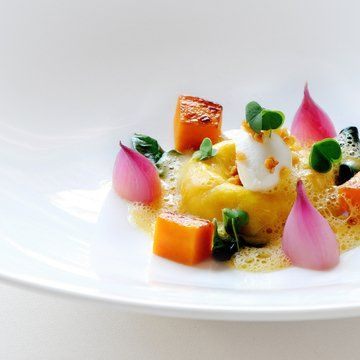 recipe for ravioli of butternut squash. Served with roasted butternut squash cubes, pickled Thai shallot and whipped gorgonzola cheese, finished with micro herbs, butternut broth and nibbed almonds. by Chef Raymond Blanc http://www.four-magazine.com