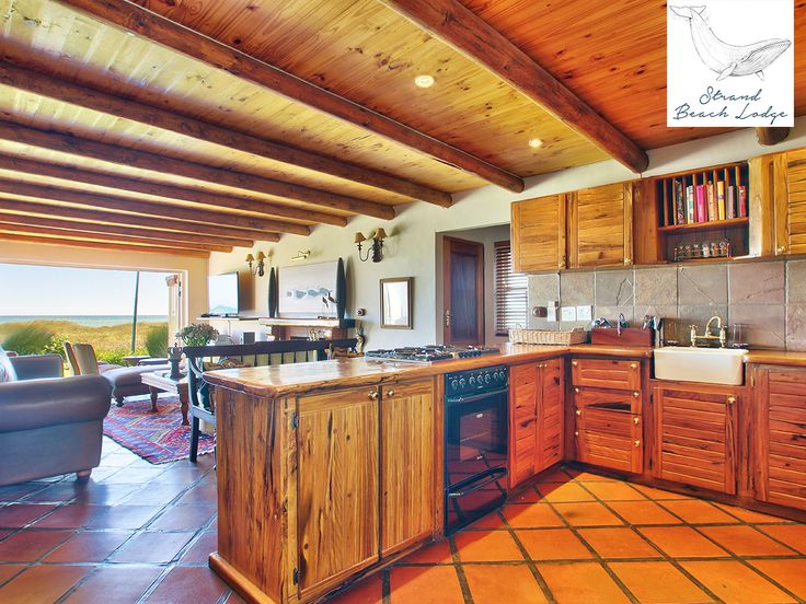 Our fully equipped kitchen begs for social meal preparation with a living area leading out to the porch, lawn and beach in front.  Link: http://ow.ly/eGEA306nuRL