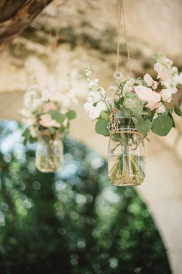 Hanging vintage pickle jars with garden roses and stock ceremony decor