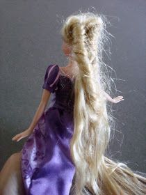 Rapunzel's hair was looking a bit  tangled  lately.              I read several ways to repair a doll's hair on pinterest, but all involved...