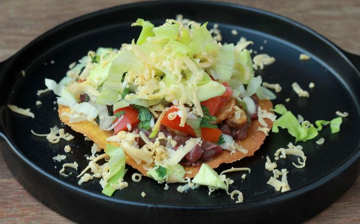 Confused what to pack into your Kid's lunch boxes..??Try out Refried Beans and Mushroom Tostada Recipe (Mexican Toasted Tortillas With Beans)-A riot of flavours textures and colour. Pack the the toppings separatelyand your kids would love assembling them. The only skill that is required is to balance the toppings and eat the Tostadas! - Recipe by Madhuli -->http://ift.tt/1mPuOTx #Vegetarian #Recipes