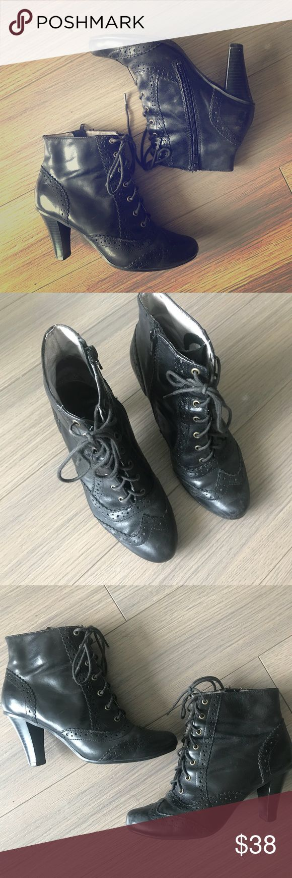 Hush puppy Oxford style boots with heel Black Oxford style heeled boots. Super cute, comes with cord laces as well as ribbon laces. Extremely comfortable and easy to wear all day. Minor scrapes on back of the heal. Hush Puppies Shoes Ankle Boots & Booties