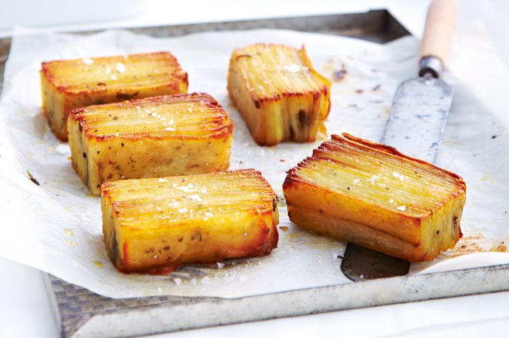 Thinly slice potatoes and layer with punchy rosemary for an elegant side.