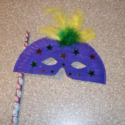Make a mask craft project -- they're made of paper plates. It's probably best to have the plates cut, glued and painted before party time and let the kids decorate them