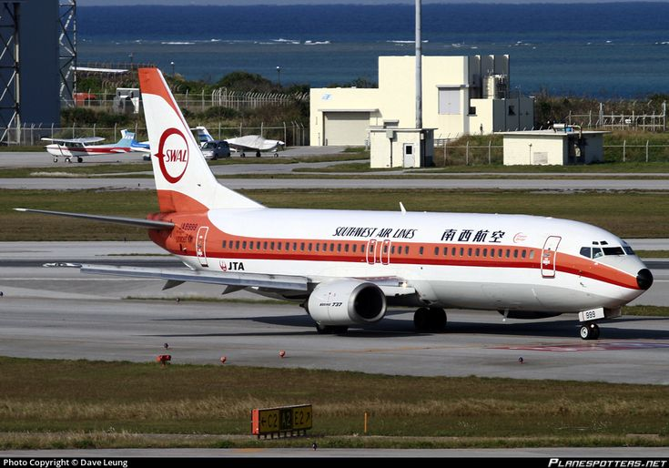 Japan TransOcean Air-JTA (JP)  Boeing 737-446 JA8999 aircraft, painted in ''South West Airlines (retro)'' special colours Mar. 2013, skating at Japan Okinawa Naha Airport. 16/03/2014. (South West Airlines was previous name).