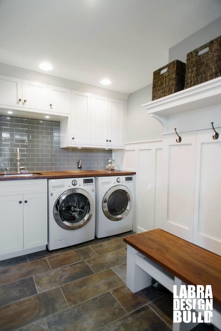 Custom Mudroom And Laundry Room Combo With White Cabinetry Wainscoting Slate Floors Walnut Wood Countertops Bench Stunning