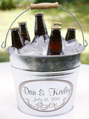 Whether you're planning a traditional wedding or a casual backyard reception, there are a ton of ways that a simple metal bucket or pail can be a fun addition t