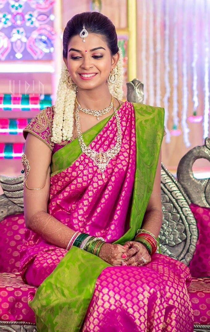 South Indian bride. Diamond Indian bridal jewelry. Jhumkis.Pink and green silk kanchipuram sari.Braid with fresh jasmine flowers. Tamil bride. Telugu bride. Kannada bride. Hindu bride. Malayalee bride.Kerala bride.South Indian wedding