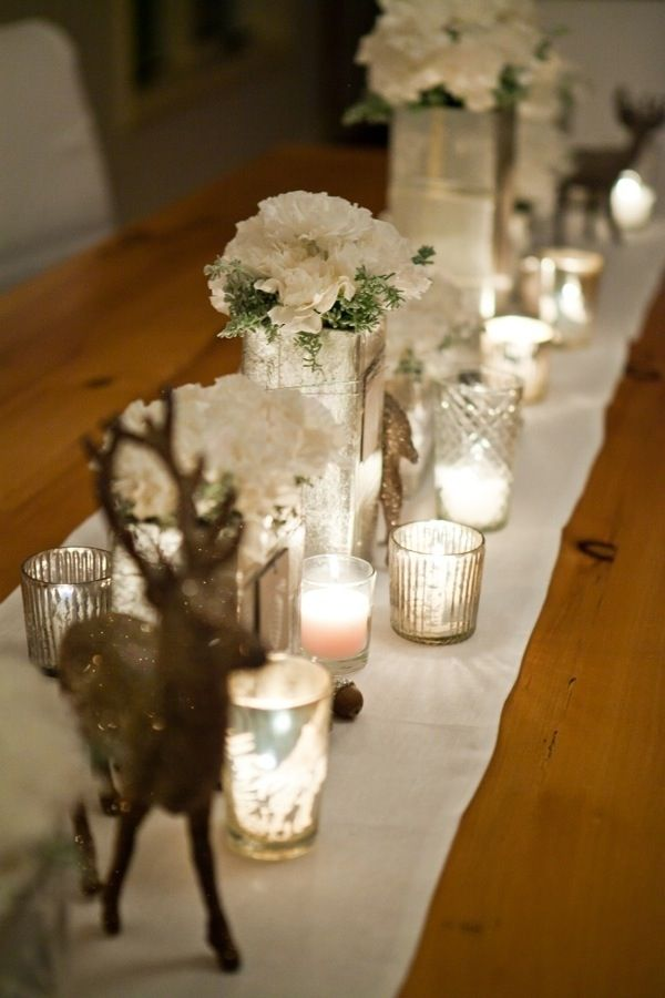 Table settings - white flowers, small hints of pine frosted with white and assorted mercury glass votives.