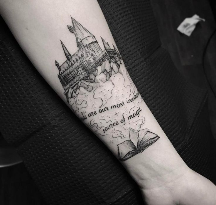 "Harry Potter arm tattoo by Carter at iHeartTattoo in Columbus OH: There is a photo of an arm with a tattoo on it. The tattoo on the arm depicts a castle with words underneath it and a book with open pages underneath the words. The words on the tattoo that can be seen in the photo are, ""...are out most inexhaus... ...source of magic."" It is a Harry Potter tattoo by Carter that was done at iHeartTattoo in Columbus, OH."