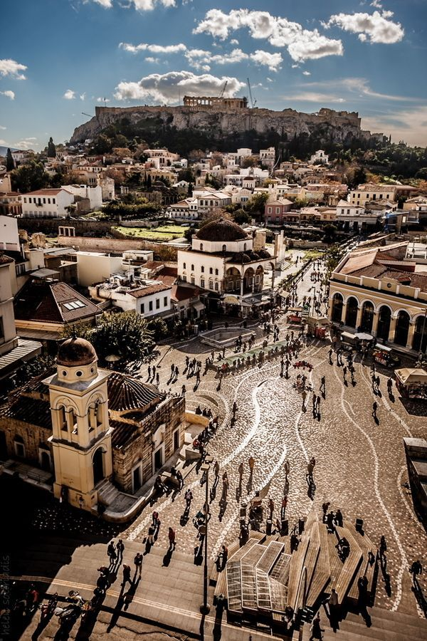 A panoramic view of the Acropolis and Monastiraki plaza in Athens, Greece.