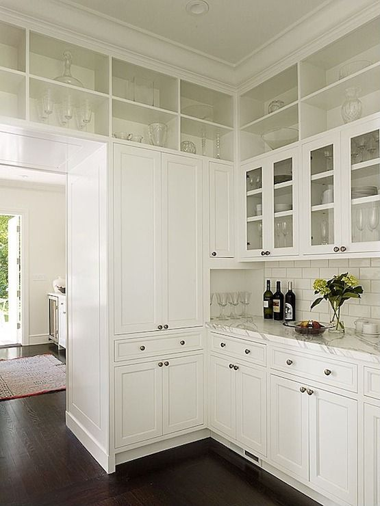 Kathleen Bost - kitchens - butlers pantry, butler pantry, cabinets over doorway, doorway cabinets, open display cabinets, glass front cabinets, white marble countertop, subway tile, subway tile backsplash,