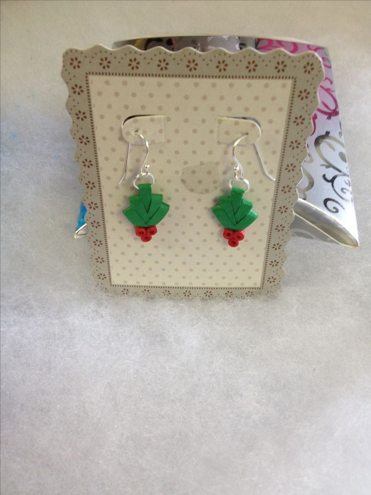 Paper quilled holly earrings.