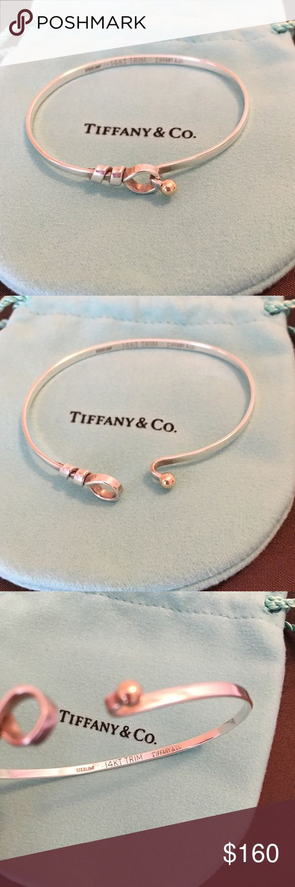 Tiffany & Co Hook and Eye Bangle Bracelet Authentic. 18K and 925 Sterling Silver. Pre-owned and worn but in good condition.  Comes with Tiffany bag. Cleaned at Tiffany San Diego in 2016. NO TRADES Tiffany & Co. Jewelry Bracelets
