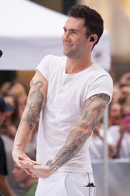 Adam Levine  As we mentioned earlier, anyone can get a tiger, but the one nestled in the crook of Adam Levine's arm steals the show from his full sleeve.  #refinery29 http://www.refinery29.com/2014/09/74254/best-celebrity-tattoos#slide-11