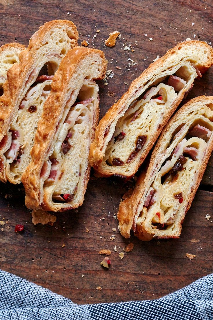 This recipe for the traditional Venezuelan Christmas bread comes from Martha Beltrán in Austin, Tex., who brought the recipe with her when she moved to the U.S. Ms. Beltrán always starts the bread the day before she serves it, laminating it with butter three times before rolling it up with ham, bacon, olives and pimentos. The process can be long, but the dough can be left in the fridge for a flexible and forgiving amount of time, even overnight. (Photo: Melina Hammer for NYT)