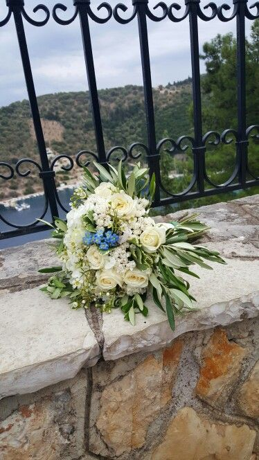 Rose, lysianthus, olive bridal bouquet with blue forget-me-not for remembrance. In Lefkas Lefkada Meganisi Greece