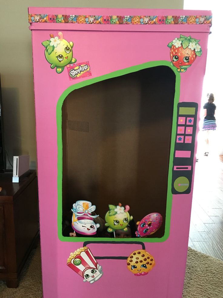 This is the vending machine photo booth I painted for my daughter's party.  I bought an extra set of the photo booth props and hot glued some to the box.