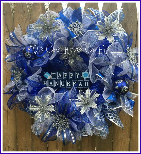 This Happy Hanukkah Wreath is a 3 layered ruffled design made with royal blue and irrodescent white Deco Mesh on a green box wire wreath form.