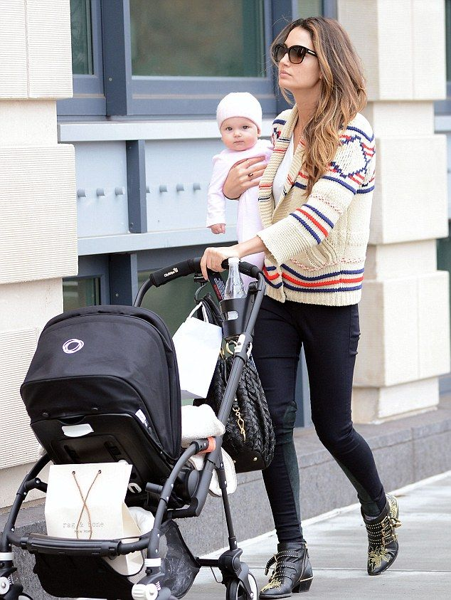 Victoria's Secret model Lily Aldridge totes cherubic baby daughter Dixie as she strolls in New York | Mail Online