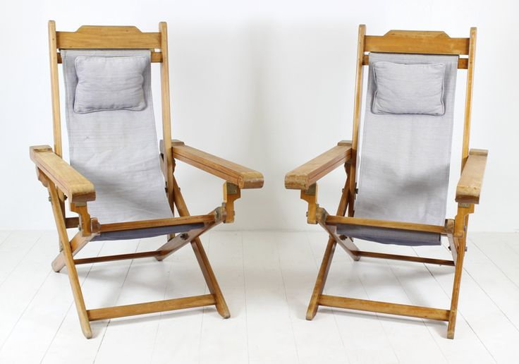 This pair of foldable Deck chairs was used on one of the French Barges that cruise the Canal du Midi. Made from Acajou timber and with brass hardware and their original faded Blue fabric, these chairs are a great find. Sold and priced as a pair. One pair only available.