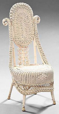 antiques price guide, antiques priceguide, furniture, America, Furniture: An American Late Victorian wicker slipper chair, circa 1900. The tall back with an oval panel over a row of aired curlicues, the stiles of scroll form, wrapping around to the demilune seat rail, now in white paint.