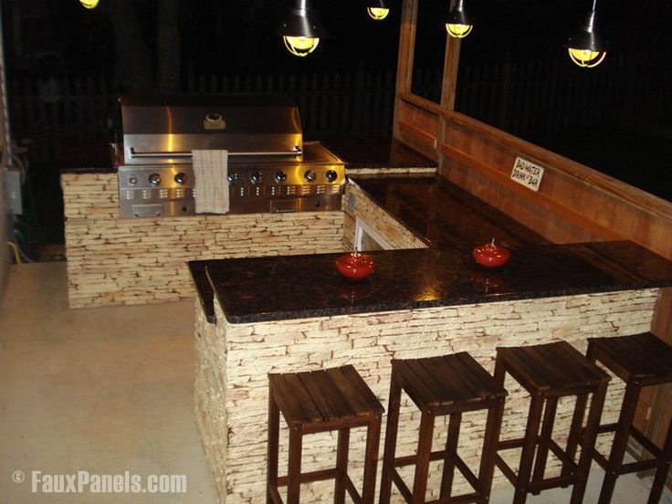 Manufactured stone paneling on outdoor grill island