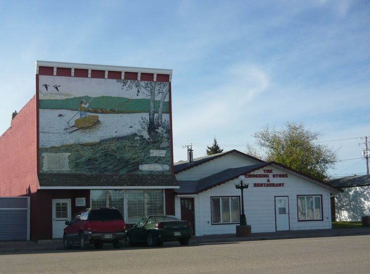 """One of the murals of Duck Lake, Saskatchewan, documenting the region's history. This mural is titled """"Crossing the Saskatchewan"""" by local artist Glen Scrimshaw."""